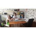Billy colouring with his sisters.