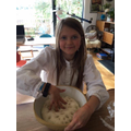 Iyla making bread.