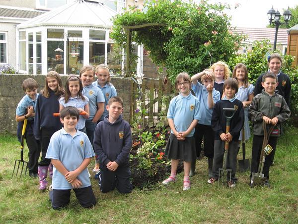 Gardening club at work in the nature garden