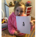 Following the video instructions to draw a penguin
