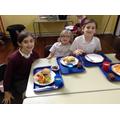 KS2 children enjoying their hot meals