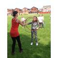 Alicia fine-tuning her hula hooping skills