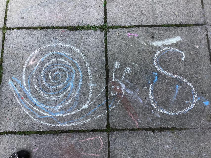We practised 's' with the chalk.
