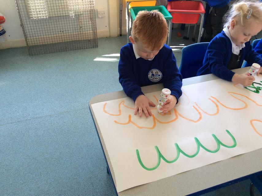 We have been practising our 'big mark making' this week.