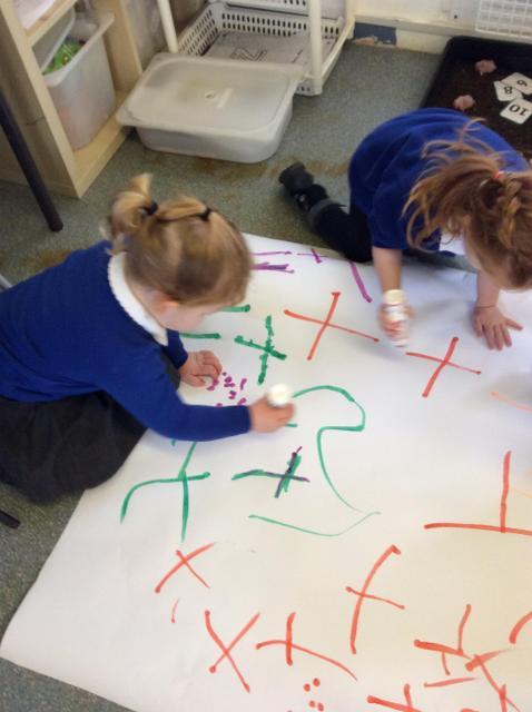 The children in Nursery love to mark make in the mark making area.