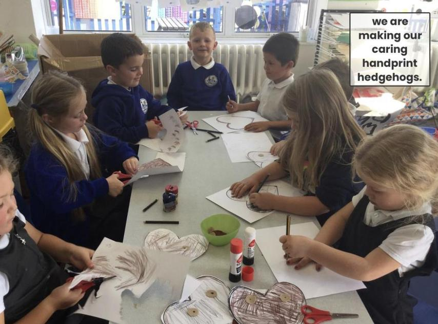 We made caring handprint hedgehogs!