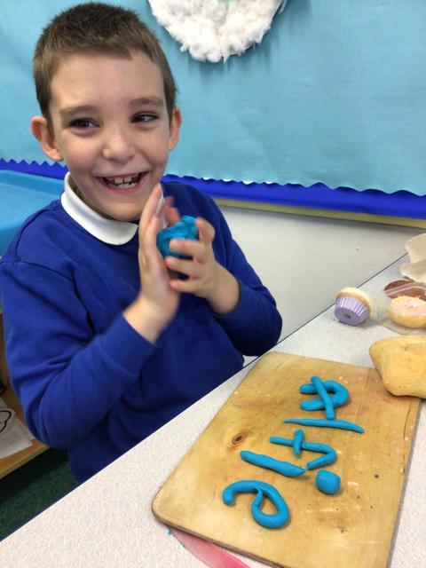 We had fun writing words with playdough.