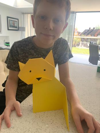 Max with an origami cat (or fox according to Max!)
