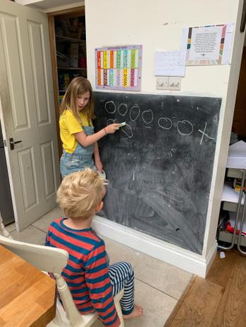 Ms Martha teaching her younger brother!