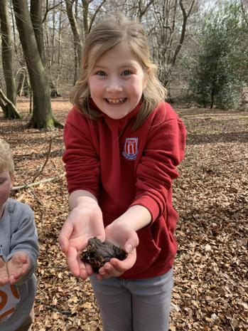 Martha enjoying nature with a friendly toad :)