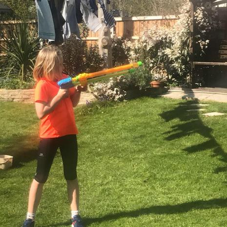 Polly soaking her brother during a water fight!
