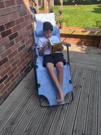 Michael enjoying reading in the garden