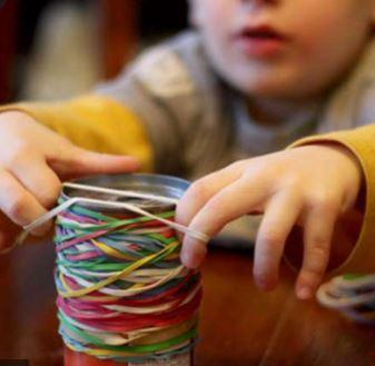 Stretching rubber bands around a can