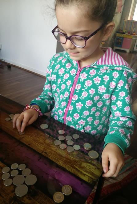 Learning types of coins.
