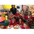 Headteacher Danielle Brown (left), teacher Becky Green and pupils.