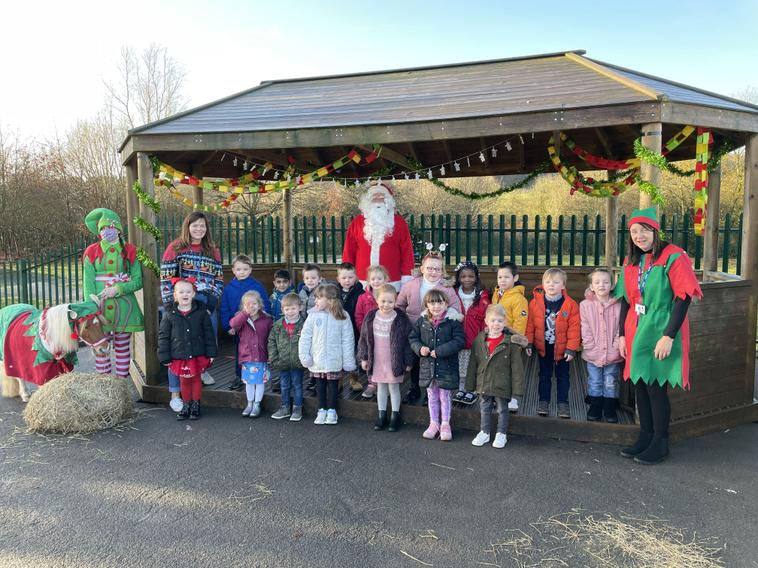 A visit from Santa and his elf and pony!