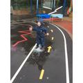Enjoying splashing in the rain