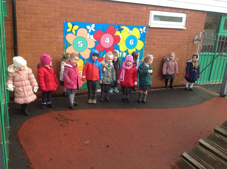 Playing together and joining in counting games.