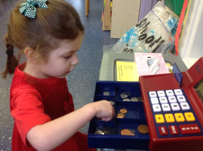 Ember helping to sort the money