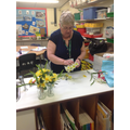 Mrs Sadgrove busily preparing the jars