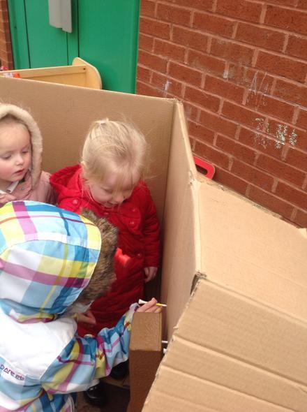 Jasmine and Frankie building a brick house...