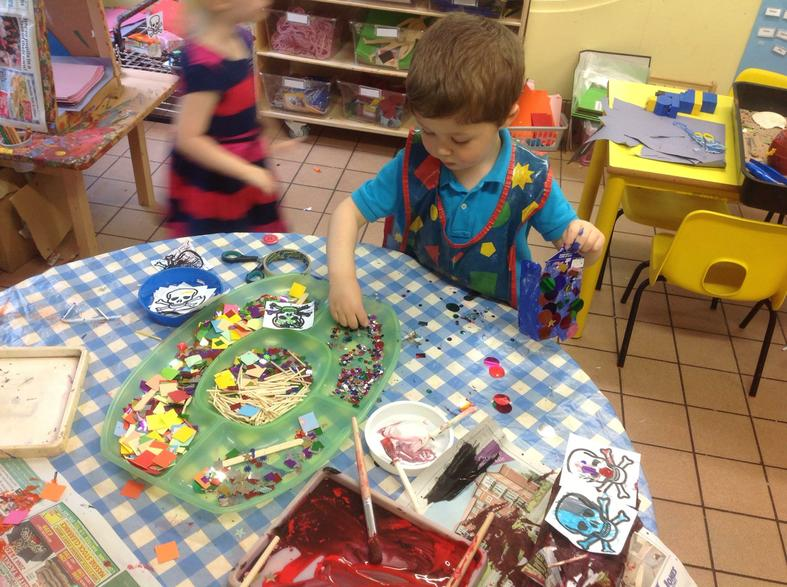 Using tools & materials to create pirate ships.