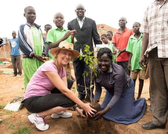 Planting a tree of friendship with the headteacher