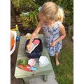 Sophia making a boat that floats.jpeg