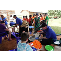 Serving lunch to the poorest children locally.
