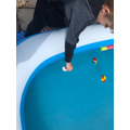 Lachlan testing his boats to see if they float or sink.jpeg