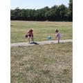Eva teaching her sister some ball skills