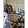 Charlotte making shepherd's pie.JPG