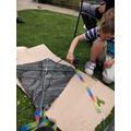 Zach making his kite