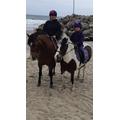 Lola riding her pony