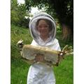 Charlotte harvesting the honey!