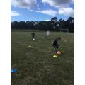 Dribbling the football