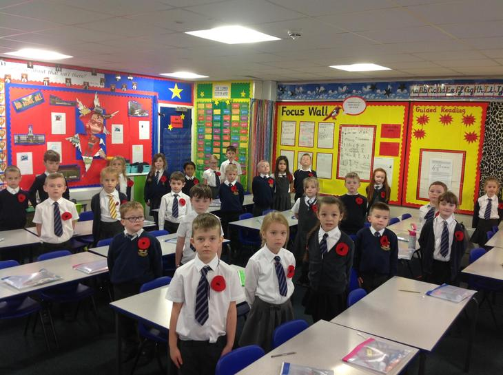 Wearing our poppies we made.