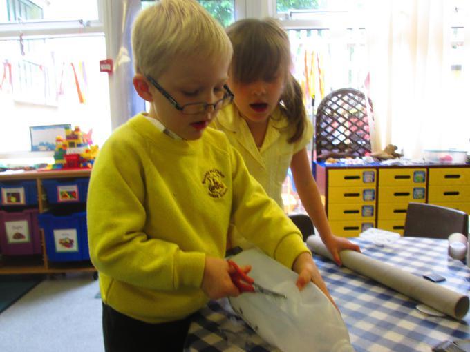 Working together to make an underwater  dinosaur
