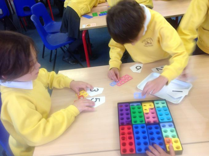 Using Numicon to help with our adding