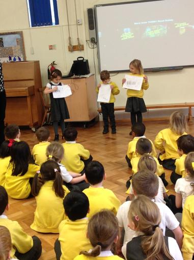 Sharing our posters in assembly