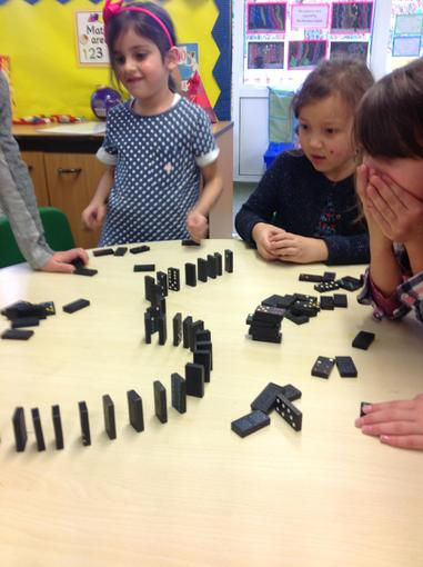 Using dominoes to describe positions, don't fall!