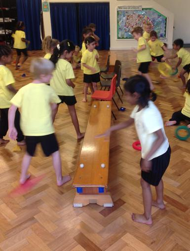 Playing 'Tidy our Bedroom' during PE