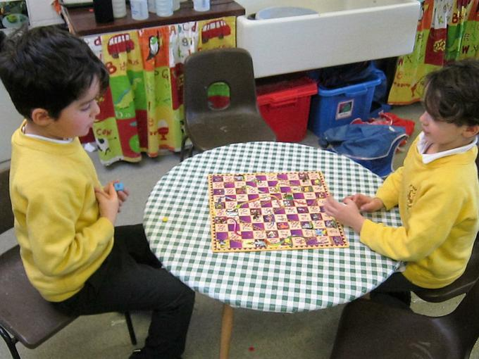 learning to play board games together