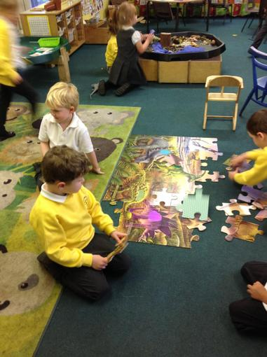 We worked together to complete dinosaur puzzles