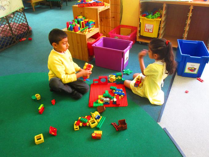 Working together to build a duplo house
