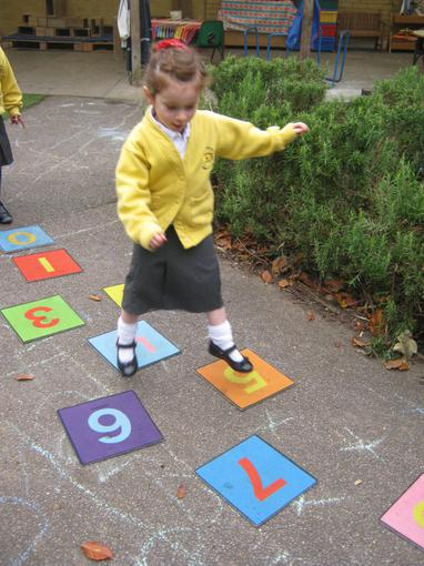 Some children introduced hopscotch outside