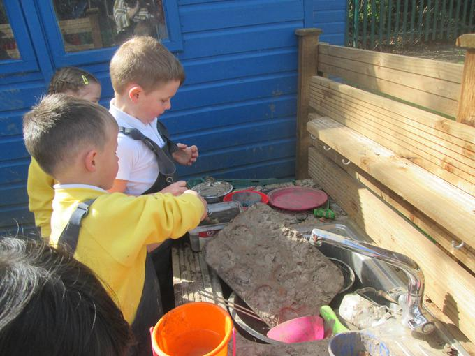 Making a birthday cake in the mud kitchen