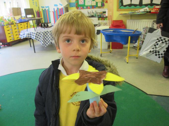 Creating his own paper flower