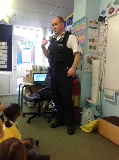 Explaining all the equipment on his uniform