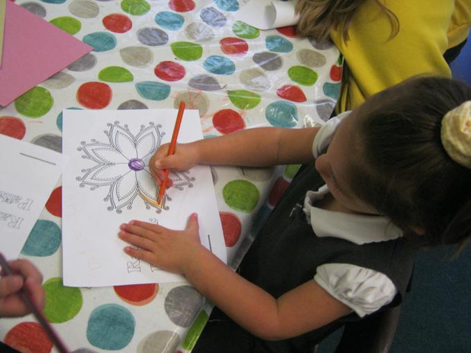 Some children carefully coloured in the patterns